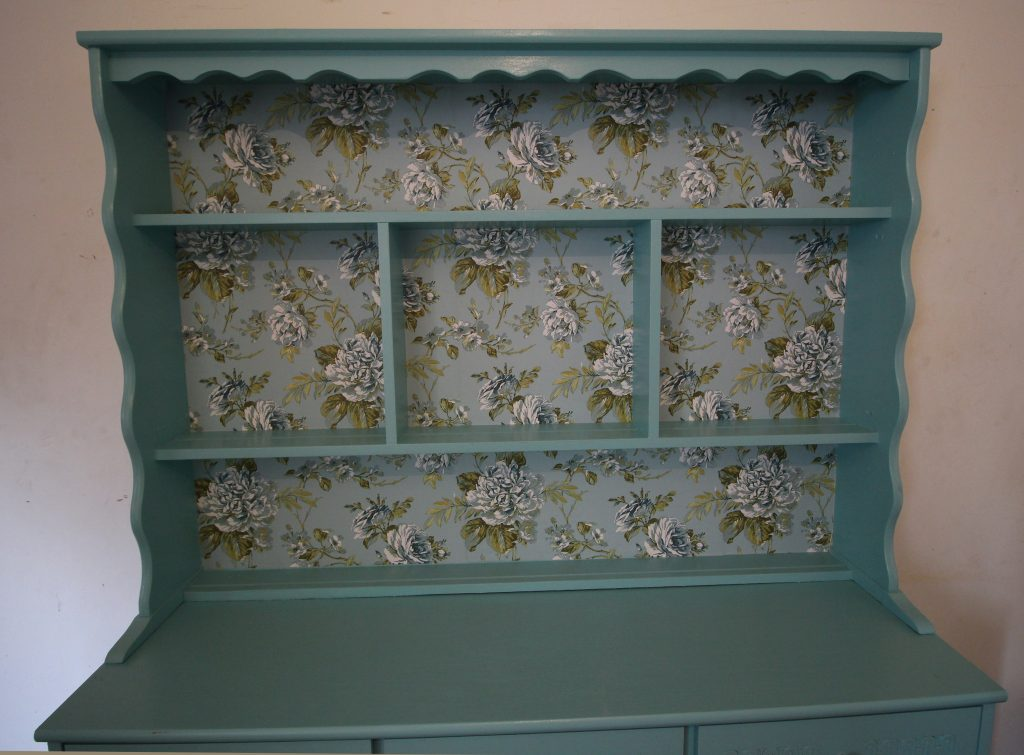 Wallpapering the back of the dresser