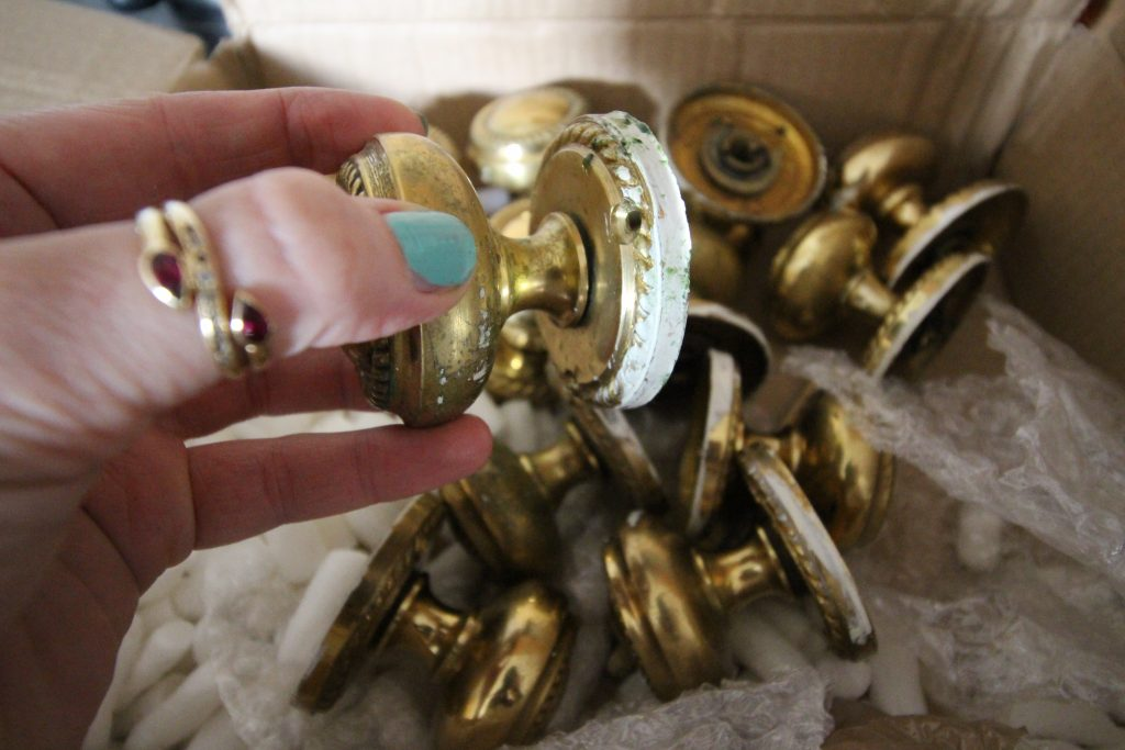 Paint-stained brass knobs before cleaning