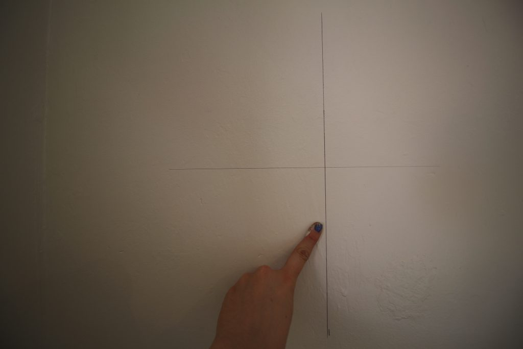 Extend your line. This is what you're going to line your first sheet of wallpaper up against