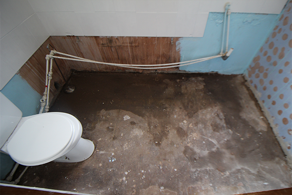 Visible damp concrete floor