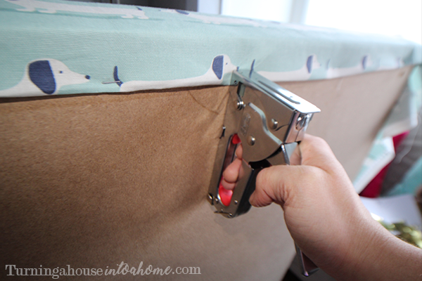 Staple the fabric in place